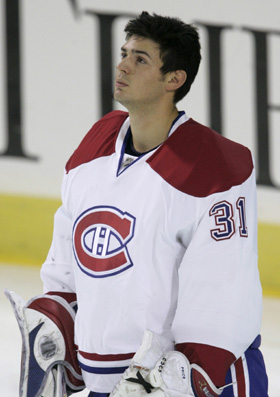 "Canadiens goalie Price listens to ""O Canada"" before start of NHL debut against the Penguins in Pittsburgh"