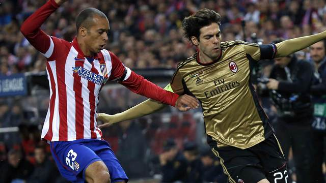 Atletico Madrid's Miranda and AC Milan's Kaka fight for the ball during their Champions League last 16 second leg soccer match at Vicente Calderon stadium in Madrid