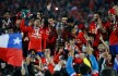 SANTIAGO, CHILE - JULY 04:  Players of Chile celebrate with the trophy after winning the 2015 Copa America Chile Final match between Chile and Argentina at Nacional Stadium on July 04, 2015 in Santiago, Chile.  (Photo by Gabriel Rossi/LatinContent/Getty Images)