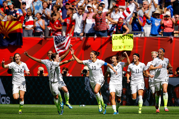 VANCOUVER, BC - JULY 05:  Carli Lloyd #10 of the United States celebrates with teammates after scoring her second goal against Japan in the FIFA Women's World Cup Canada 2015 Final at BC Place Stadium on July 5, 2015 in Vancouver, Canada.  (Photo by Kevin C. Cox/Getty Images)
