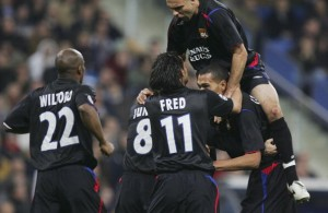 MADRID, SPAIN - NOVEMBER 23:  Lyon players celebrate after John Carew (Bottom Right)  scored a goal during the UEFA Champions League group F, match between Real Madrid and Olympique Lyon at the Bernabeu stadium on November 23, 2005 in Madrid, Spain.(Photo by Denis Doyle/Getty Images)