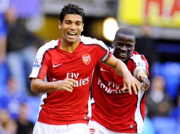 LIVERPOOL, ENGLAND - AUGUST 15: Da Silva Eduardo of Arsenal celebrates with teammate Emmanuel Eboue (R) after scoring his team's sixth goal during the Barclays Premier League match between Everton and Arsenal at Goodison Park on August 15, 2009 in Liverpool, England. (Photo by Michael Regan/Getty Images)