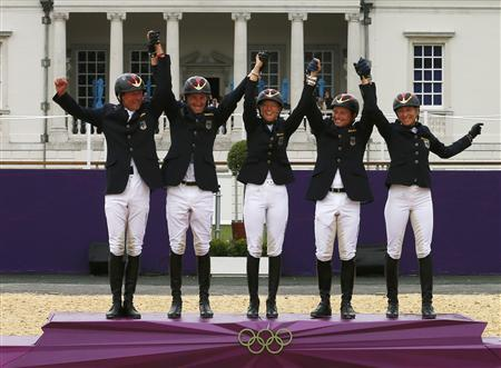 (L-R) Germany's Peter Thomsen, Dirk Schrade, Sandra Auffarth, Michael Jung and Ingrd Klimke celebrate before receiving their gold medals in the Eventing Team Jumping equestrian event victory ceremony at the London 2012 Olympic Games in Greenwich Park, July 31, 2012. REUTERS/Eddie Keogh