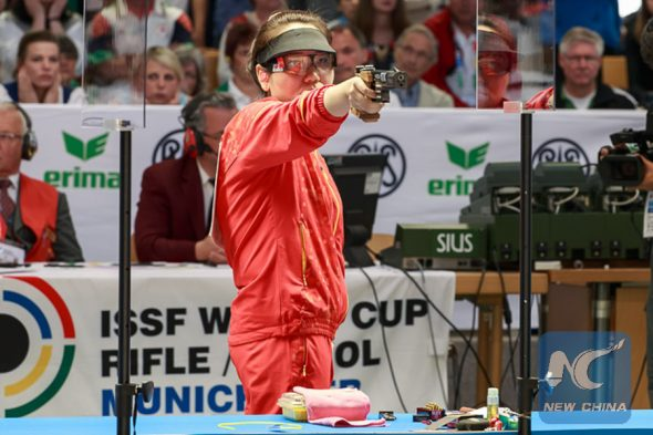 MUNICH - MAY 29: Gold medalist Jingjing ZHANG of the Peoples Republic of China competes in the 25m Pistol Women Finals at the Olympic Shooting Range Munich/Hochbrueck during Day 2 of the ISSF World Cup Rifle/Pistol on May 29, 2015 in Munich, Germany. (Photo by ISSF Photographers)