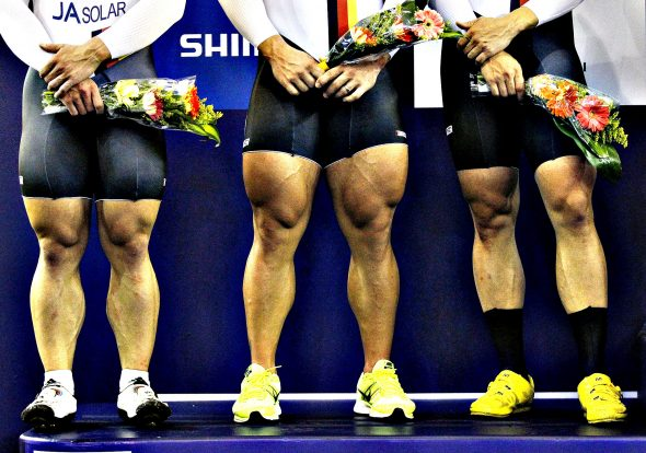 The legs of second placed German team, including Rene Enders, Robert Forstemann and Maximilian Levy are pictured during the ceremony in the men's team sprint race at the 2014 UCI Track Cycling World Championships in Cali...The legs of second placed German team, including Rene Enders, Robert Forstemann and Maximilian Levy are pictured during the ceremony in the men's team sprint race at the 2014 UCI Track Cycling World Championships in Cali February 26, 2014. REUTERS/Jaime Saldarriaga (COLOMBIA - Tags: SPORT CYCLING TPX IMAGES OF THE DAY)