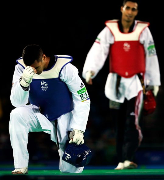 RIO DE JANEIRO, BRAZIL - AUGUST 20: Pita Nikolas Taufatofua of Tonga reacts after being defeated by Sejjad Mardani of Iran during Men's +80kg Taekwondo competition at the Rio 2016 Olympic Games on August 20, 2016 in Rio de Janeiro, Brazil. (Photo by Getty Images/Getty Images)