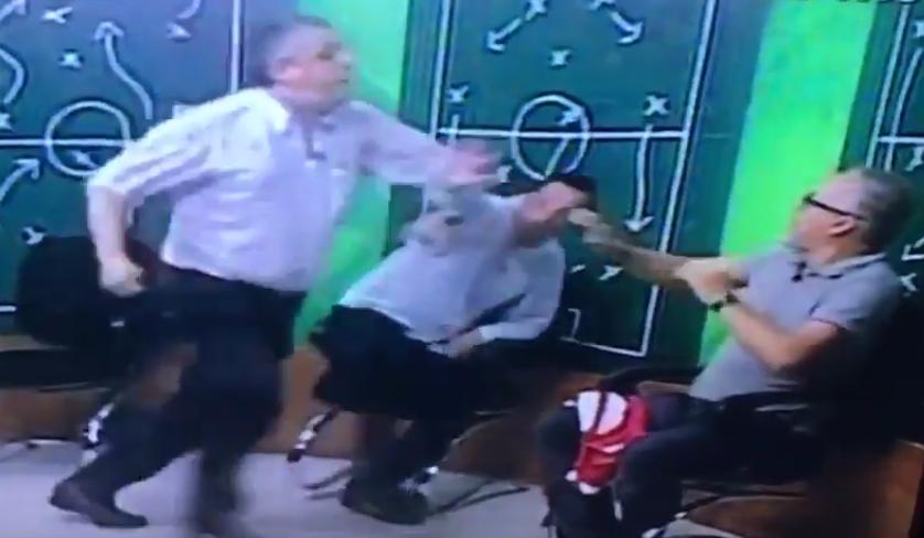 Resultado de imagem para Ex-presidente do Inter acerta soco em jornalista ao vivo na TV